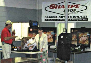 Sharpe Bros. employees enjoy a buffet meal and prizes to celebrate the two-year mark.
