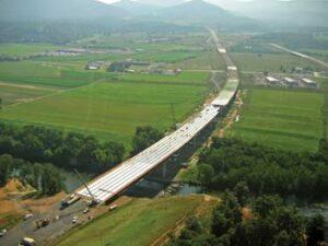 Bridge Crew Pours It On To Overcome Flood Delays