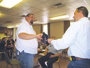 Jason Cox, left, receives a company hat and gift card from Bob Kennedy at a safety luncheon in Beckley, WV.