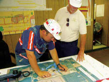 Simon Stepp, Manager of Engineering for Patton Mining, looks over a Deer Run site map with V&G Project Manager Ray Adkins. (Photo by Carl Thiemann)