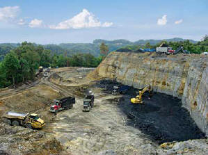 Vecellio & Grogan removed more than 50 feet of overburden and sloped back the high wall to prepare a coal mine site for Peach Tree Mining in Bolt, WV.