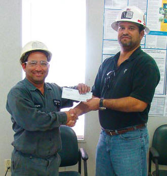 """Rolayme Fabelo, left, is White Rock Quarries' 2012 Safety Phrase contest winner with """"Chance Takers Are Accident Makers."""" At right is WRQ Safety Director Tony Diaz. (Photo by JR Payne)"""