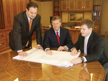 Michael, left, and Christopher Vecellio with their father, Leo Vecellio, Jr., at the office in 2007.