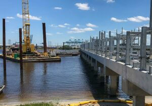 a crane on a barge at a pier construction site