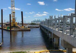 a crane on a barge at a pier construction site
